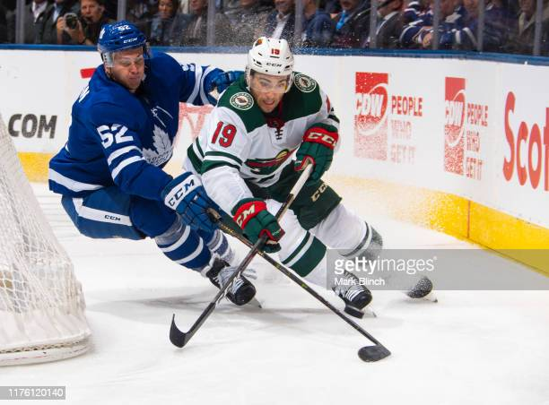 Luke Kunin of the Minnesota Wild battles for the puck against Martin Marincin of the Toronto Maple Leafs during the second period at the Scotiabank...