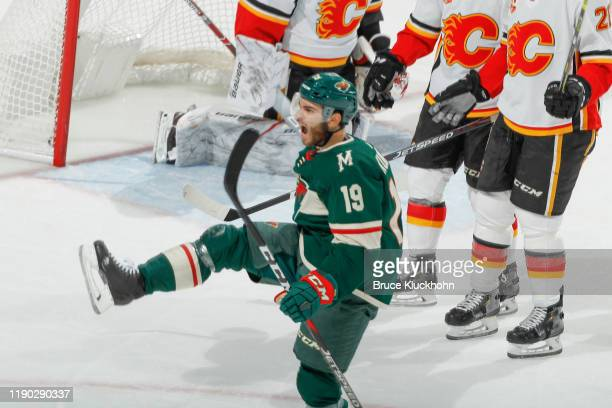 Luke Kunin of the Minnesota Wild celebrates after scoring a goal against the Calgary Flames during the game at the Xcel Energy Center on December 23,...