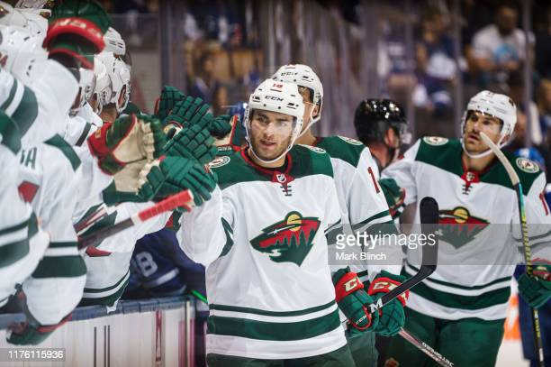 Luke Kunin of the Minnesota Wild celebrates his goal against the Toronto Maple Leafs during the first period at the Scotiabank Arena on October 15,...