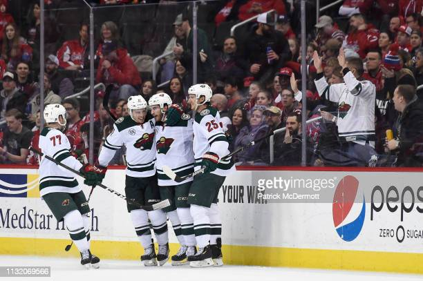 Luke Kunin of the Minnesota Wild celebrates with his teammates after scoring a goal in the third period against the Washington Capitals at Capital...