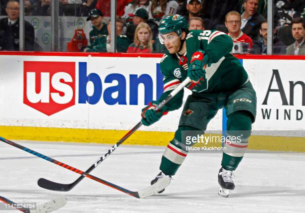 Luke Kunin of the Minnesota Wild makes a pass during a game with the Winnipeg Jets at Xcel Energy Center on April 2, 2019 in St. Paul, Minnesota.