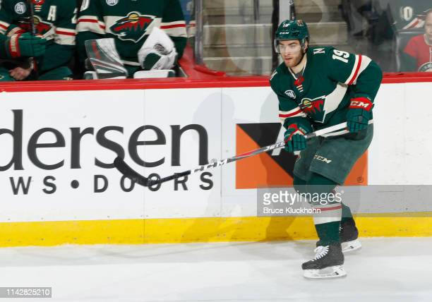 Luke Kunin of the Minnesota Wild makes a pass during a game with the Boston Bruins at Xcel Energy Center on April 4, 2019 in St. Paul, Minnesota.