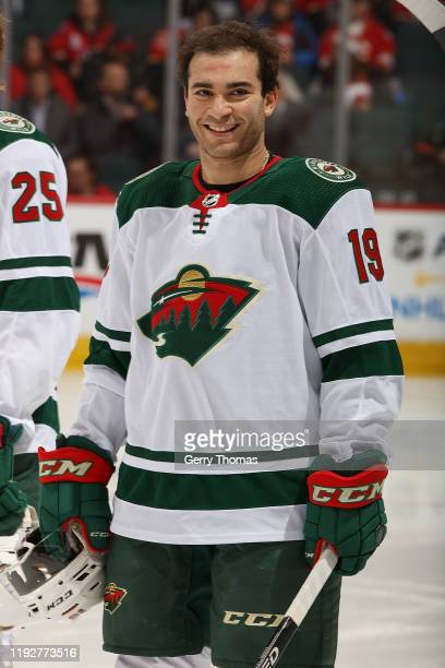 Luke Kunin of the Minnesota Wild stands for the anthems prior to puck drop against the Calgary Flames at Scotiabank Saddledome on January 9, 2020 in...