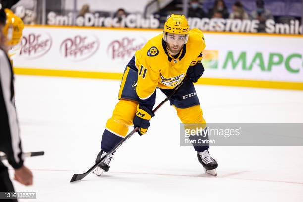 Luke Kunin of the Nashville Predators awaits a face off during the first period against the Florida Panthers at Bridgestone Arena on April 26, 2021...