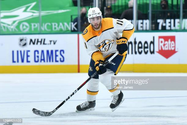 Luke Kunin of the Nashville Predators handles the puck against the Dallas Stars at the American Airlines Center on January 24, 2021 in Dallas, Texas.