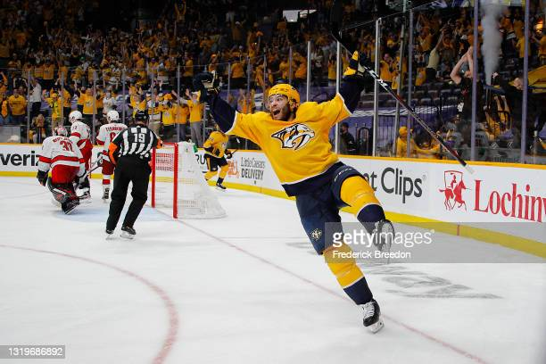 Luke Kunin of the Nashville Predators reacts after scoring the game winning goal against the Carolina Hurricanes during the second overtime period in...