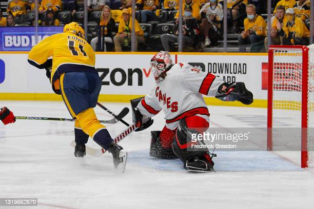 Luke Kunin of the Nashville Predators scores a goal against Alex Nedeljkovic of the Carolina Hurricanes during the first period in Game Four of the...