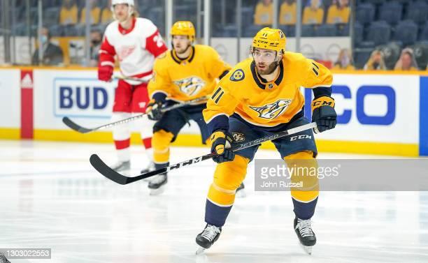 Luke Kunin of the Nashville Predators skates against the Detroit Red Wings at Bridgestone Arena on February 13, 2021 in Nashville, Tennessee.