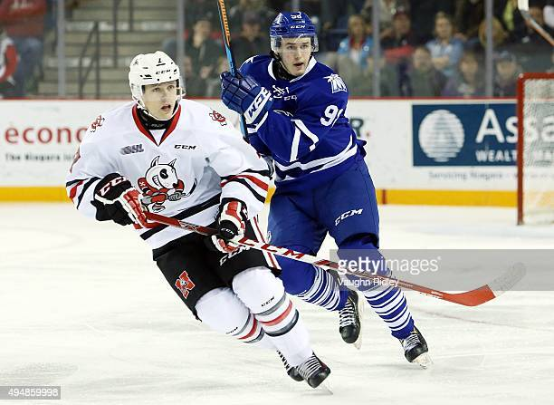 Luke Kutkevicius of the Mississauga Steelheads and Mikkel Aagaard of the Niagara IceDogs skate during an OHL game at the Meridian Centre on October...
