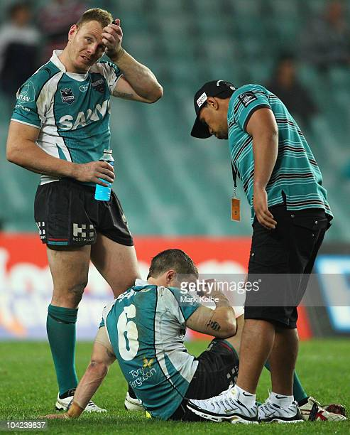 Luke Lewis and Travis Burns of the Panthers look dejected after their loss in the second NRL semi final match between the Sydney Roosters and the...
