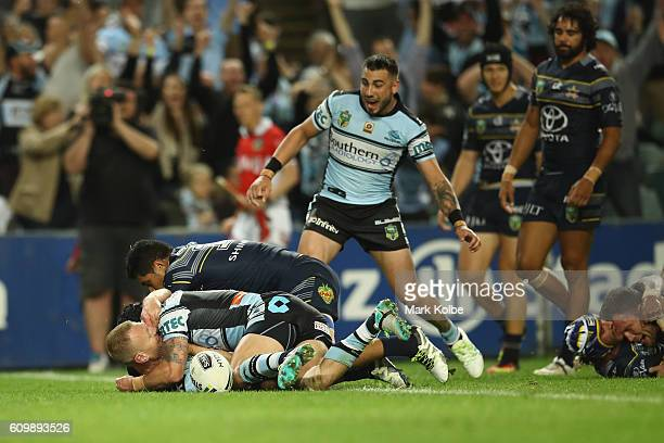 Luke Lewis Michael Ennis and Jack Bird of the Sharks celebrate Lewis scoring a try during the NRL Preliminary Final match between the Cronulla Sharks...