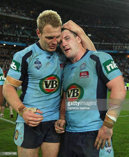 Luke Lewis of the Blues embraces captain Paul Gallen after winning game two of the ARL State of Origin series between the New South Wales Blues and...