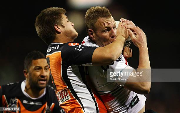 Luke Lewis of the Panthers is tackled during the round 19 NRL match between the Wests Tigers and the Penrith Panthers at Campbelltown Sports Stadium...