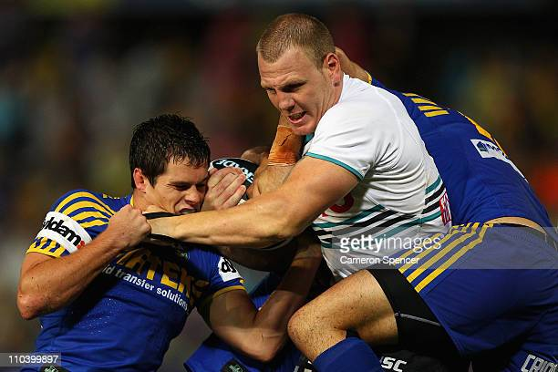 Luke Lewis of the Panthers is tackled during the round two NRL match between the Parramatta Eels and the Penrith Panthers at Parramatta Stadium on...