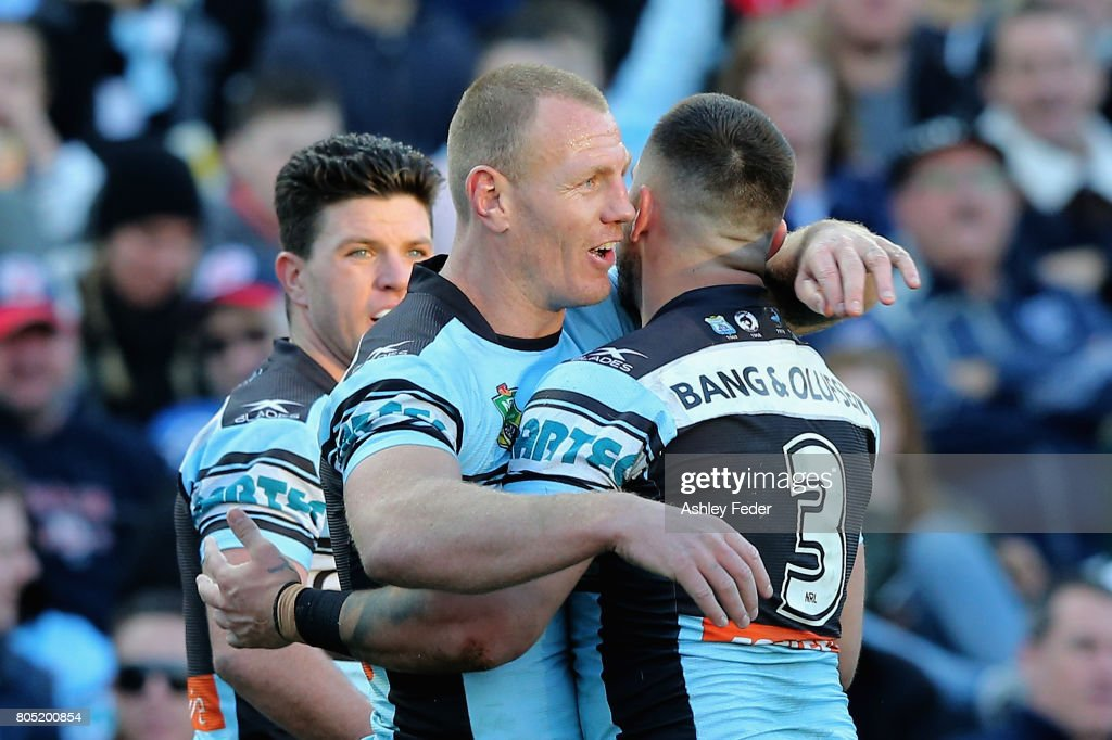 Luke Lewis of the Sharks celebrates a try with team mates during the round 17 NRL match between the Sydney Roosters and the Cronulla Sharks at Central Coast Stadium on July 1, 2017 in Gosford, Australia.