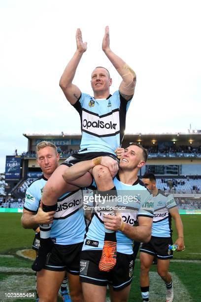 Luke Lewis of the Sharks is chaired off the field after playing his final home game winning the round 24 NRL match between the Cronulla Sharks and...
