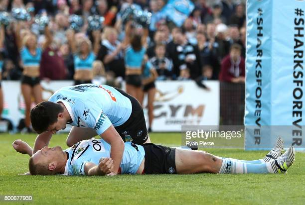 Luke Lewis of the Sharks is congratulated by Chad Townsend of the Sharks after scoring a try during the round 16 NRL match between the Cronulla...