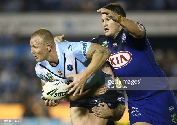 Luke Lewis of the Sharks is tackled by Greg Eastwood of the Bulldogs during the round 12 NRL match between the Cronulla Sharks and the Canterbury...