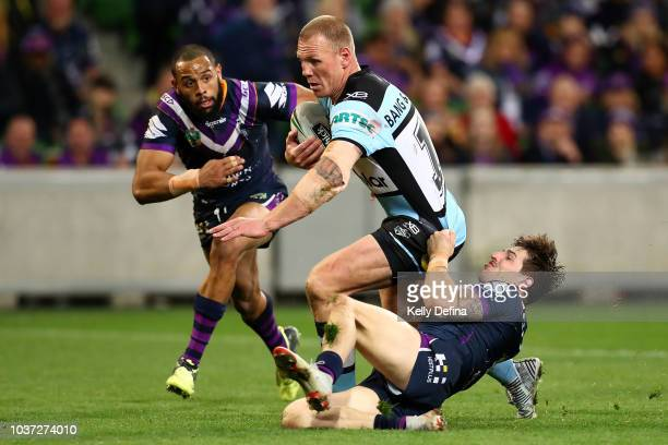 Luke Lewis of the Sharks is tackled by the Storm defence during the NRL Preliminary Final match between the Melbourne Storm and the Cronulla Sharks...