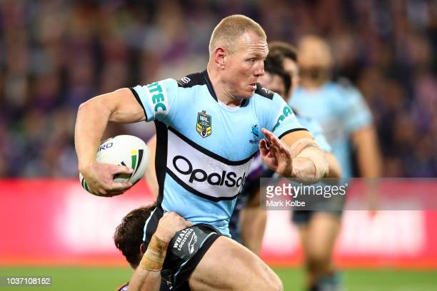 Luke Lewis of the Sharks is tackled during the NRL Preliminary Final match between the Melbourne Storm and the Cronulla Sharks at AAMI Park on...