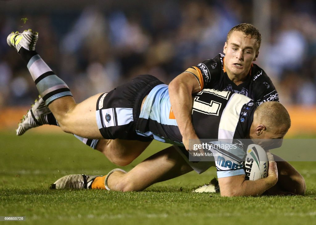 Luke Lewis of the Sharks is tackled during the round 15 NRL match between the Cronulla Sharks and the Wests Tigers at Southern Cross Group Stadium on June 17, 2017 in Sydney, Australia.