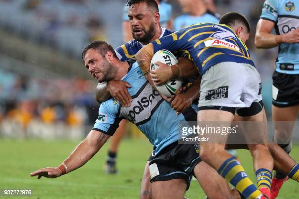 Luke Lewis of the Sharks is tackled during the round three NRL match between the Parramatta Eels and the Cronulla Sharks at ANZ Stadium on March 24...