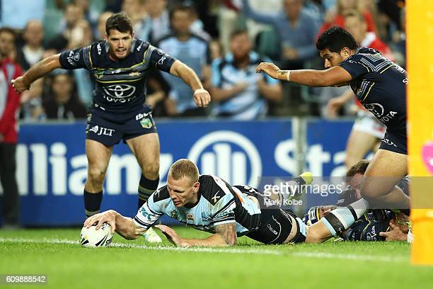 Luke Lewis of the Sharks scores a try during the NRL Preliminary Final match between the Cronulla Sharks and the North Queensland Cowboys at Allianz...