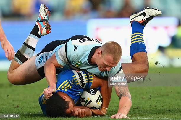 Luke Lewis of the Sharks tackles Kelepi Tanginoa of the Eels during the round five NRL match between the Parramatta Eels and the Cronulla Sharks at...