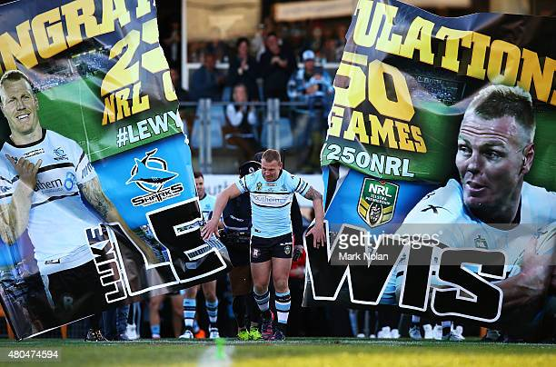 Luke Lewis runs through his banner before the round 18 NRL match between the Cronulla Sharks and the St George Illawarra Dragons at Remondis Stadium...