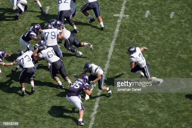 Luke Lippincott of the Nevada Wolf Pack carries the ball against the Northwestern Wildcats on September 8, 2007 at Ryan Field at Northwestern...