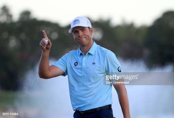 Luke List acknowledges the crowd on the 18th hole during the final round of The Honda Classic at PGA National Resort and Spa on February 25, 2018 in...