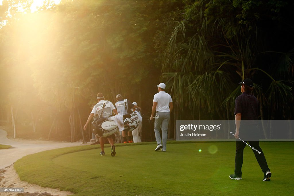 Luke List (C) and Derek Fathauer (R) of the United States walk off the 8th green during the second round of the OHL Classic at the Mayakoba El Camaleon Golf Club on November 13, 2015 in Playa del Carmen, Mexico.