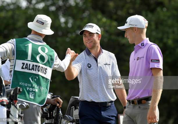 Luke List bumps fist with a caddie on the first hole during the final round at the Korn Ferry Tour's Korn Ferry Challenge at TPC Sawgrass at Dyes...