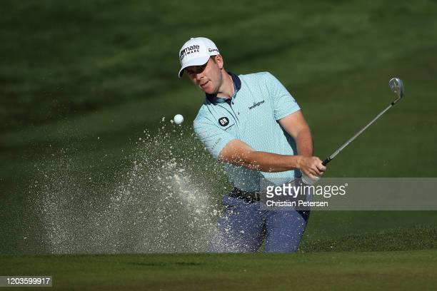 Luke List chips from the bunker onto the second green during the final round of the Waste Management Open at TPC Scottsdale on February 02, 2020 in...