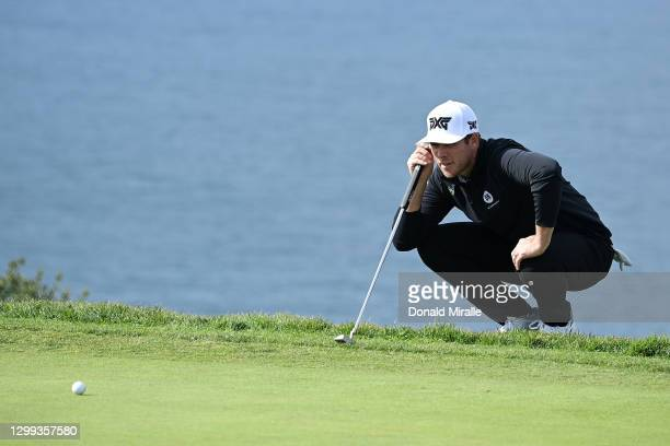 Luke List lines up his putt on the 4th hole green during round two of the Farmers Insurance Open at Torrey Pines on January 29, 2021 in San Diego,...
