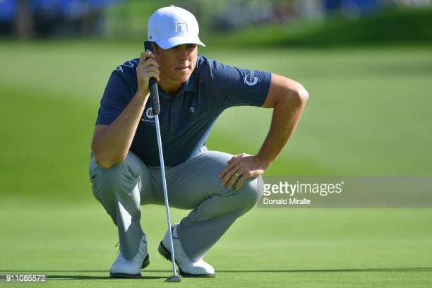 Luke List looks over a putt on the first green during the third round of the Farmers Insurance Open at Torrey Pines South on January 27 2018 in San...