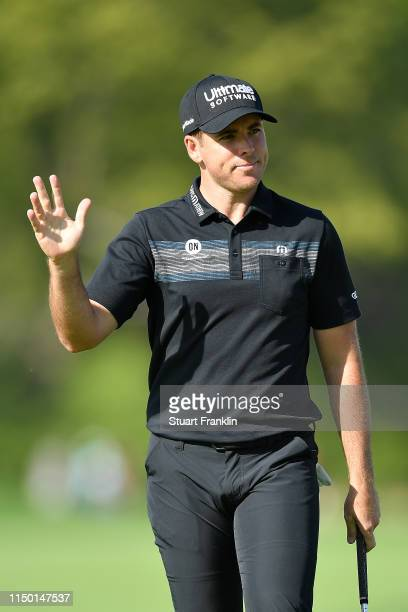 Luke List of the United States chips in on the 12th hole during the third round of the 2019 PGA Championship at the Bethpage Black course on May 18,...