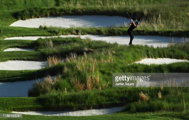 Luke List of the United States plays a second shot on the 18th hole during the third round of the 2019 PGA Championship at the Bethpage Black course...