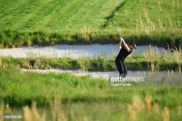 Luke List of the United States plays a shot from a bunker on the 18th hole during the third round of the 2019 PGA Championship at the Bethpage Black...