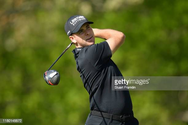Luke List of the United States plays a shot from the 13th tee during the third round of the 2019 PGA Championship at the Bethpage Black course on May...