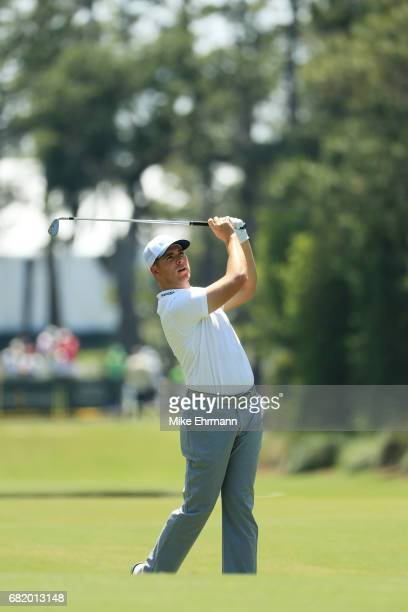 Luke List of the United States plays a shot on the tenth hole during the first round of THE PLAYERS Championship at the Stadium course at TPC...