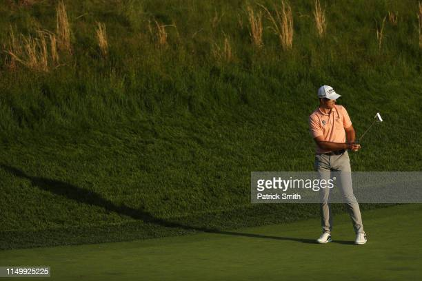 Luke List of the United States prepares to putt on the eighth green during the second round of the 2019 PGA Championship at the Bethpage Black course...