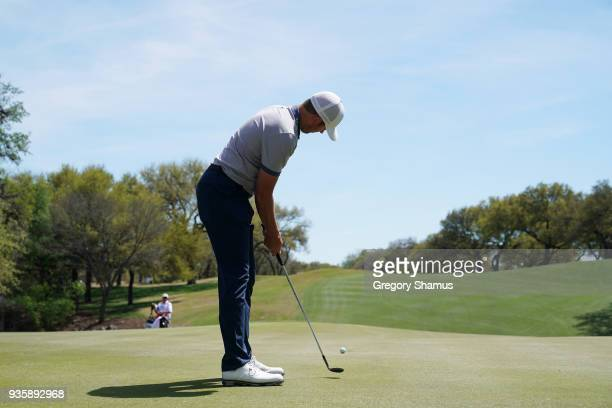 Luke List of the United States putts with a wedge on the 18th green during the first round of the World Golf ChampionshipsDell Match Play at Austin...