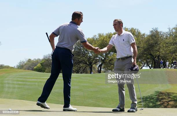 Luke List of the United States shakes hands with Justin Thomas of the United States after Thomas defeated List 2 Up during the first round of the...