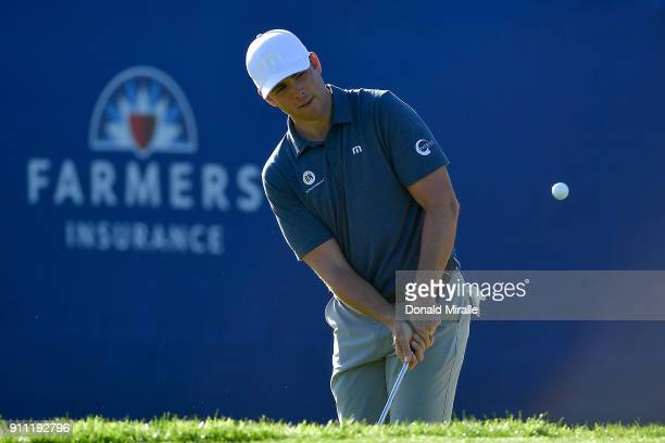 Luke List plays a shot from a bunker on the 17th hole during the third round of the Farmers Insurance Open at Torrey Pines South on January 27 2018...