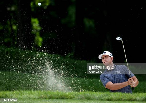 Luke List plays a shot from a bunker on the ninth hole during the second round of the John Deere Classic at TPC Deere Run on July 09, 2021 in Silvis,...