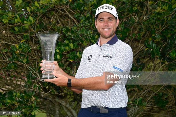 Luke List poses with the trophy after the final round at the Korn Ferry Tour's Korn Ferry Challenge at TPC Sawgrass at Dyes Valley Course on June 14,...