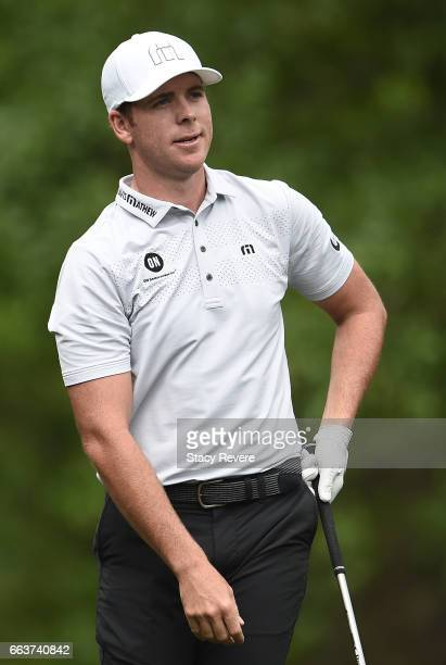 Luke List reacts after hitting his tee shot into the rough on the second hole during the final round of the Shell Houston Open at the Golf Club of...