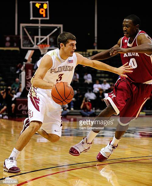 Luke Loucks of the Florida State Seminoles drives against Justin Knox of the Alabama Crimson Tide during the Old Spice Classic at Disney's Milk House...