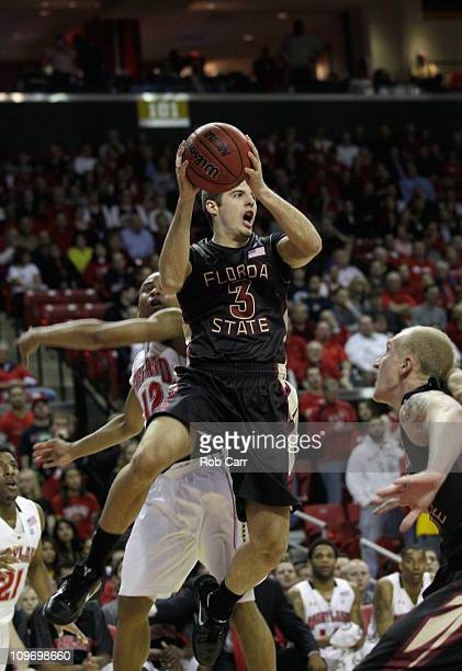 Luke Loucks of the Florida State Seminoles passes around Terrell Stoglin of the Maryland Terrapins at the Comast Center on February 23 2011 in...
